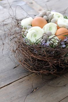 Natural looking Easter decoration with nest, eggs, stones and flowers.