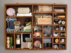 looks like an old printer's tray or shadow box. Great way to display my vintage sewing odds & ends that are just sitting in a box on a shelf now. My Sewing Room, Sewing Box, Sewing Rooms, Sewing Spaces, Vintage Sewing Notions, Vintage Sewing Machines, Vintage Sewing Patterns, Sewing Crafts, Sewing Projects