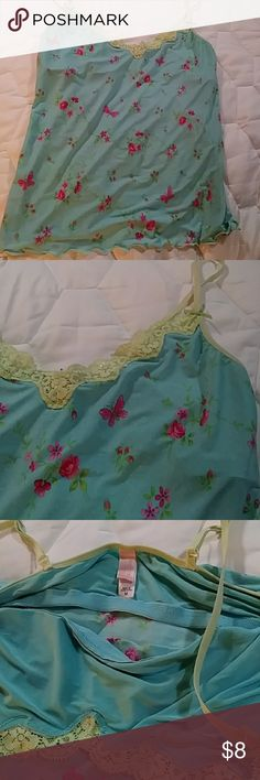 Victoria's Secret Camisole Size M Worn twice this Victoria's Secret blue w/pink flowers & butterflies & light lime green trim & lace is in perfect condition & super soft and silky w/built-in bra support. The only flaw is a lil burn on the inside i showed it in the pics and that u cant see it on the outside so no one but u knows it's there. Can be worn out or to lounge. Size medium. Victoria's Secret Intimates & Sleepwear
