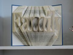 Folded Book Art Sculpture  Family by   Marcy Bates of RecycledReads on Etsy