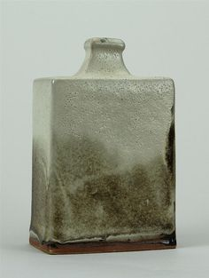 Shoji Hamada, Japanese (1894-1978), Press-moulded rectangular bottle, tenmoku under nuka; height: 7 3/4 - by Maynards Fine Antiques