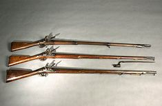 American Revolutionary War muskets. Would give anything to have one of these above my mantle