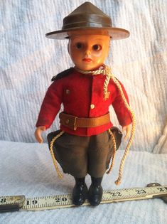 Not vintage plastic mounty toy something is