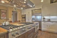Traditional Kitchen with Gas range top, Millstead Antique Maple Bronze Random Length Solid Real Hardwood Flooring, One-wall