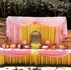 Pink and yellow dessert table at a Beauty and the Beast birthday party! See more party ideas at CatchMyParty.com!