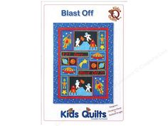 """Kids Quilts Blast Off Pattern- Space the """"final frontier"""" captures every child's imagination, sooner or later. Do you have a budding astronaut on your hands? If so, make them this quilt, whose blocks are filled with applique images of planets, stars, rocket ships, astronauts, and friendly aliens. Finished size about 61.5 x 82.5 in. Includes instructions, diagrams, and paper patterns."""