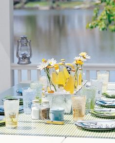 Fill a metal planter with ice and flowers to turn it into a bright beverage cooler. For an easy centerpiece, tuck fresh-picked wildflowers into empty bottles among the cold drinks.