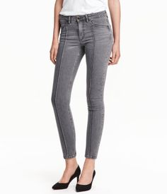 Gray. 5-pocket, low-rise jeans in washed stretch denim with skinny, ankle-length legs. Concealed zip at hems.