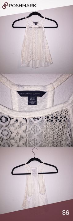 American Eagle White lace crop top Barely used American Eagle white lace crop top  Size XS Bundling and offers accepted (: ▪️Buy one get one half off applies to all unsold items in my closet. Discount will be applied to least expensive item. American Eagle Outfitters Tops Crop Tops