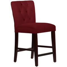 Functional and fabulous, this tufted counter stool adds modern style to your home with its red velvet fabric and espresso legs. The solid pine construction ensures long-lasting strength, and the foam padding means comfort for your family and guests.