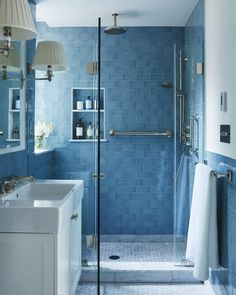 USA Nickel Silver rotary dimmer light switch in a striking blue bathroom.