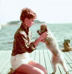 """Audrey Hepburn with one of her Poodle co-stars, during filming of """"Sabrina"""" (1954)."""