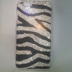 Zebra iPhone 6 Hard Shell case All Blinged out! Black /white zebra print iPhone 6 hard shell cover, like new condition only used a few times, get your Bling! Bling! on ❌❌NO TRADES ❌❌ ‼️BUNDLE & SAVE‼️ Accessories