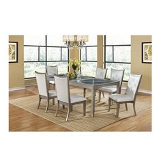 Shimmering like the sea with a silver-gray finish and gold undertones, the Ellen Extendable Dining Table Set adds a delightful element to your dining experience. The set, harnessed from rubberwood and birch veneers, explores curved legs balancing two clear glass inserts via an X-shaped wooden crest.