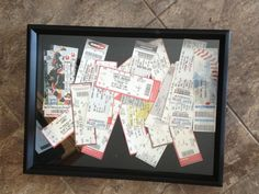 Shadow box with ticket stubs scattered inside.    Perfect for the basement sports bar being built in my house.
