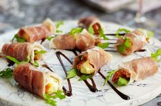 "Parma ham {prosciutto} and mozzarella bites ~ and the ""rocket"" means arugula! 