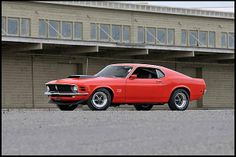 Rare, Multiple Award-Winning 1970 Boss 429 Fastback.  This car is also 1 of only 89 1970 Boss 429's painted in Calypson Coral. Do not let the clean and sleek feel of the car fool you. This car was a barn car that was known to very few dedicated car hunters. Once found, it was restored using NOS parts. Under the hood, Aldridge Motorsports rebuilt its engine to bring back the power of the 429/375hp engine.
