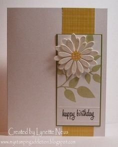 A sweet daisy will surely get a smile for this handmade birthday card. A strip of golden paper brings out the yellow center, against the green stamped leaves.