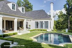 White and gray with big back porch and dark pool- Melissa Haynes