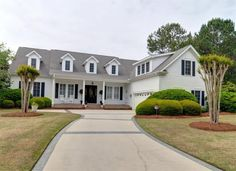 """8705 Champion Hills Dr, Wilmington, North Carolina 28411 Located on the 15th green of Porters Neck Plantation sits this beautiful, 4 bedroom custom built, low country style home boasting over 4600 sq. ft.  The spacious, floor plan is ideal for hosting guests for formal occasions or just a """"Guy's Night"""" to watch a game in the den/man cave that features a wet bar and built-ins."""