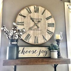 New Clock from Pier One, Families are Forever wood sign, Black lantern and new vase with some florals. Above the murphy bed.