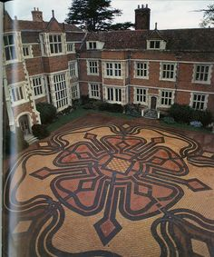 """Magical Labyrinths and mazes in the 21st Century Paths, Jeff Saward.    Modern. The """"Tudor Rose"""" maze by Minotaur designs, fills much of the central court yard of Kentwell Hall in Suffolk, Eastern England.    I copied as a good example of what ought to have been done with the paving stones in Sugarhouse."""