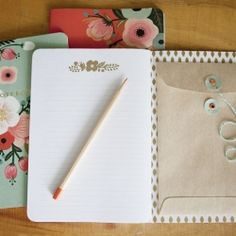 Personalize a pretty notebook with a special pocket to contain memorabilia, special notes and so much more.