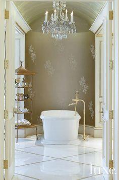 Luxury bathroom in Boca Raton. MTI tub, granite & onyx floor, hand-painted wall detail by Mindy Sherman.