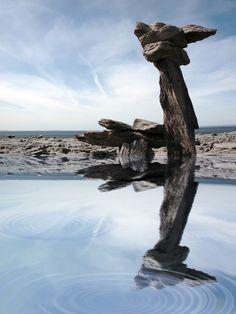 standing stones reflected in water on the Burren in Ireland. David Morrison