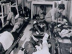 Australian Nurses treat patients in the Camp Hospital.