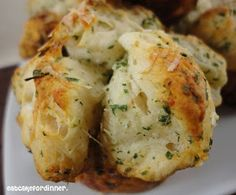 Garlic Monkey Bread - 2 cans buttermilk biscuits, 6 T butter, 3 cloves garlic, 2 T dried parsley flakes, 1/4 c grated Parmesan cheese (plus 2 Tbl. to sprinkle on top)