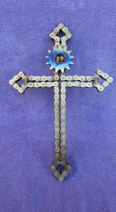This cross or crucifix is built from discarded motorcycle chain. Its a solid piece fully welded to hold its shape and ready to hang to display. by helena Welding Crafts, Welding Art Projects, Metal Art Projects, Blacksmith Projects, Diy Welding, Welding Ideas, Diy Projects, Metal Sculpture Artists, Steel Sculpture