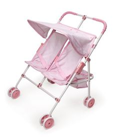 """$36.45-$31.99 Baby An ideal, compact stroller when your doll wants to bring along a friend! Folds flat and also includes storage baskets, swivel front wheels, a canopy, and more. Overall size of 18""""W x 16""""D x 22""""H. Seats measure 7""""W x 5.5""""D x 10.5""""H. Rubber handle grips. Two baskets behind the seats each measure 5""""L x 6""""W x 3""""H. Double wheels in front. Single wheels in back. Folding, double wide ..."""