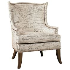 Add a stylish touch to your living room or master suite with this lovely arm chair, featuring French script upholstery and nailhead trim.