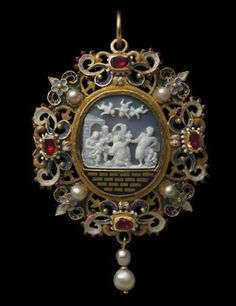 The onyx cameo represents the Three Kings (also known as Magi, or Wise Men) symbolic of earthly power and authority, adoring the Infant Christ. One of the Magi, kneels before the baby, who reaches out for his gift, watched by the Virgin Mary and by St. Joseph. The other two Magi prepare to offer their gifts. A choir of angels in the sky above rejoice above the ruins, symbolic of the Old Order, changed by the birth of Christ. (tbc)