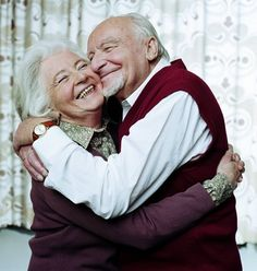 High-Res Stock Photography: Mature couple embracing smiling close up