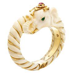 VAN CLEEF and ARPELS A Multi-Gem, Ivory and Gold 'Elephant' Bangle at 1stdibs