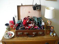 Scarf storage in vintage luggage