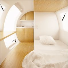 Ecocapsule: A Tiny Home for Eco-Travelers| EcoBuilding Pulse Magazine | Modular Building, Prefab Design, Green Design, Rainwater Catchment, Solar Cells, Solar Power, Wind Power - weighs 3,306 pounds, compact, easy to transport.  Can be shipped, airlifted, towed or pulled by a pack animal.