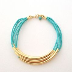 Faux Wrap Turquoise Bracelet -- gold tube beads and turquoise cord bracelet . handmade jewelry by MoshPoshDesigns. via Etsy.