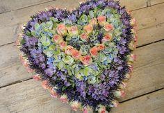 Rouwarrangement lila hart