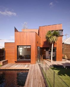Located in Melbourne, Australia, the Barrow House has been designed by Andrew Maynard Architects with an arrangement of timber boxes that create a stylish variety of shapes to get the eye.