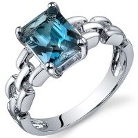 Love me some blue topaz-and what a neat setting.