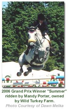 The Country Classic - Oregon Hunter Jumper Horse Show, look at how he has his legs to the side to be sure not to bump the top rail....