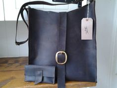 Dark brown leather bag with matching wallet by HenandTillLeather