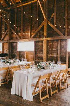 barn reception - photo by Emily Delamater Photography http://ruffledblog.com/shady-lane-farm-wedding