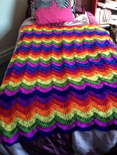 My finished Rainbow Waves crochet blanket (pattern free on redheart.com)