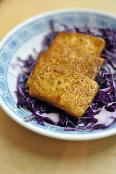 Teriyaki Tofu Steaks 1/2 14-oz block of tofu (silken or firm, whatever you like) 1 tbsp sesame oil 2 tbsp soy sauce 1 tbsp sake 1 tbsp mirin 1 tsp sugar 1 tsp grated ginger shichimi pepper (optional