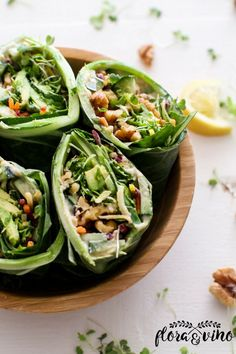 Easy collard green wraps stuffed with hummus, avocado, walnuts, and a refreshing blend of rainbow veggies. Light and easy, these wraps are perfect to throw together for an easy lunch or dinner. #glutenfree #vegan #oilfree #floraandvino