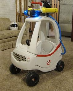 Custom-Made GHOSTBUSTERS Kids Ecto-1 Cozy Coupe. This? Coolest kid car, EVER. Hands down. Sorry, Ghostbusters nerd. LOL!